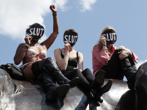 117269-women-sit-on-a-lion-in-trafalgar-square-during-a-rally-after-slutwalk-